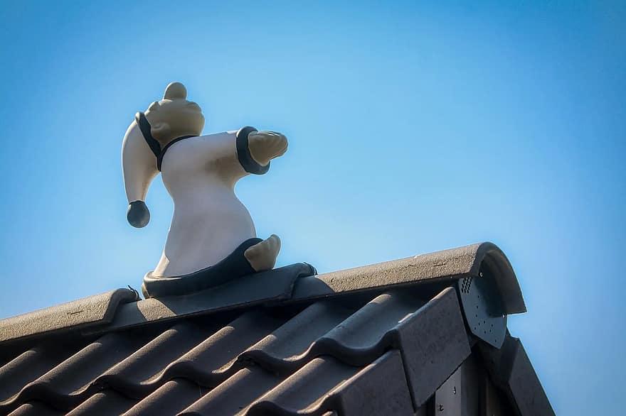 Sleepwalking statue on roof